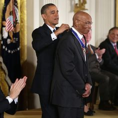 Ernie Banks receiving the Presidential Medal of Freedom from Barack Obama.