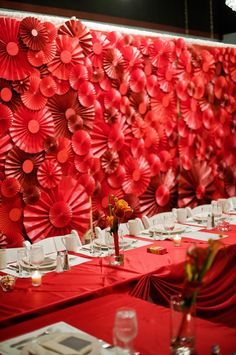 rosette pinwheel backdrop for the reception! Photo by Anna Page