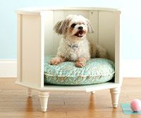 repurposed end table as a dog bed or cat bed