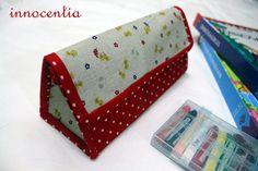 Toblerone bag tutorial!  http://www.myinnocentia.com/2010/10/triangular-pouch-tutorial.html