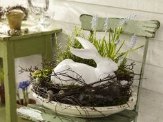 Easter/Spring ~ Bunny in a twiggy nest with blooming spring bulbs  (via wohnideen.minimalisti)