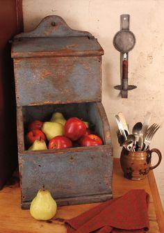 Prim bin with apples