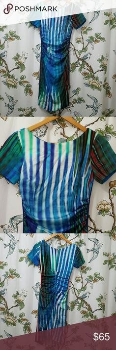 "Tracy reese abstract watercolor stripe dress 0 Short sleeve figure hugging. This is very flattering and curve enhancing. Im 5'5"" and this is about knee length on me. Colorful dress with contrasting stretchy stripe trim down both sides. Back zip. Lined. 92% silk 8% spandex. Dry clean only. PLEASE Note -  tiny rubbed spot in back where zipper ends. There is some writing on materials tag inside and label feels a little loose. Measures 35.5"" length in back,  40"" long in front. Bust 15""-17.5""…"