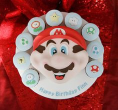 Super Mario Cake and Cupcakes by The Great Little Food Company, via Flickr