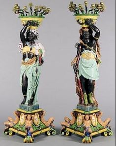"""Monumental (72"""") Majolica Blackamoor Slave or Prince and Princess Candelabra. Minton. Designed by A.E Carrier Belleuse. Also with fruit basket or jardiniere atop. This pair one of only 12 in existence. From the Majolica International Society Archive, Sotheby's, London photo."""
