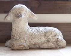 antique concrete lamb statue