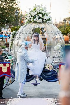 A gorgeous bride arrives to her Disney's Fairy Tale Wedding in Cinderella's Coach