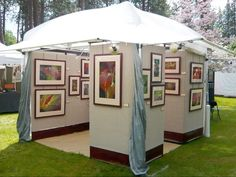 """Evolution of an art booth - check this page for more photos of the same display - Craft booth v4. New tent, Propanels, final """"baseboards"""" (v2)."""