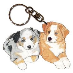 Australian Shepherd Wooden Dog Breed Keychain Hang out with your best friend all day and show the world who holds the key to your heart! These Australian Shepherd dog key rings are proudly made in the USA.