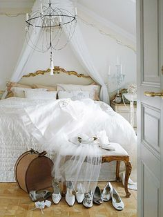 Vintage and glamorous bedroom in white