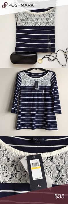 Tommy Hilfiger top with lace detail Tommy Hilfiger 3/4th sleeve top. Dark blue and white. White lace detail on the neck. Body is 100% cotton, lace is 80% cotton and 20% nylon. Very soft and comfortable.  PRICE FIRM. Lowballs. Tops Tees - Long Sleeve