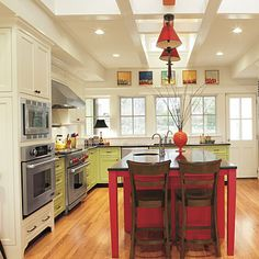 Delicious Design;In this new kitchen, intersecting timbers cross the ceiling to capture vintage character. via Southern Living