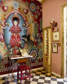 Designer: Catalina Estrada, Barcelona, Spain Inspired by Little Red Riding Hood, this wall mural is a decorative feast for the eyes, with many patterns and motif's. The colors are vibrant and coordinate well with the other decor in the room.