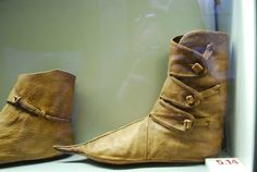 Viking Ankle boots (recreated). I like the closure and top seam on these boots. The page that posted this picture cites them as artifacts of the Viking Museum Haithabu, Schlegwig, Germany http://www.museen-sh.de/ml/inst.php?inst=10010000760&s=2&t=1&sparte=museen&pid=