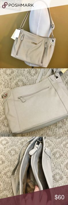 Medium hobo purse in mushroom Medium handbag in color mushroom. HOLY POCKETS! There are so many places you can store things in this beauty! The front has two zipper pockets, which do not connect, both are separate. The back has a small pocket. Inside the purse there are three sections. The front and back sections are open, and the middle section has a zipper closure, and inside that pocket is yet another pocket! Truly beautiful purse. Múltisac Bags Hobos