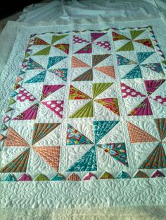 This is an adorable pinwheel baby quilt I just quilted for a customer. Clm: love the quilting on this Scrappy Quilts, Patchwork Quilting, Easy Quilts, Longarm Quilting, Free Motion Quilting, Mini Quilts, Machine Quilting Patterns, Quilt Patterns, Patchwork Patterns