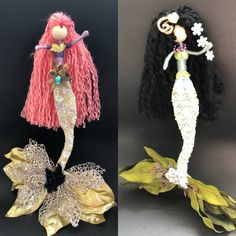 This is my second series Mermaid art doll. they have different tails, one is a velvety green tail and the other is a gold leaves tail. Their bodies have gold lace and the other has pearl trim . Their beautiful hair is made with knitting yarn. My fairy dolls are liked and bought for all
