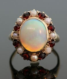 Antique Opal Garnet and Pearl Ring by SITFineJewelry on Etsy, $1350.00. This almost looks like a color variation on Princess Diana's engagement ring.