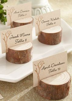 """When it's all about trees and nature, only genuine wood will do. This stunningly simple, genuine-wood place card/photo holder adds to the beauty of any setting where family, friends, and the beauty of nature are gathered. Features and facts:  Circular genuine-wood place card/photo holder with visible age circles and a slit on the top for place card or photo  Place card holder measures approximately 1"""" h x 1 3/4"""" in diameter  Coordinated place cards included  Sold as a set of 4View Alternate…"""