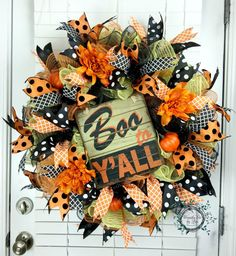 24 x 24 x 10 Deco Mesh Boo To Yall Ruffle Deco Mesh Wreath - Fall/Halloween Wreath - Fall/Halloween Decor - Door Decor hand-crafted by myself with three rolls of 10 mesh, one Lime Jute, Orange Jute, and Black Metallic using the ruffle technique. Included four different wire-edged ribbons, three pumpkins, three orange silk dahlias, and one Boo To Yall sign. This wreath is worked on a black 24 work wreath form. The wreath would make the perfect gift or wonderful for your own front door or…