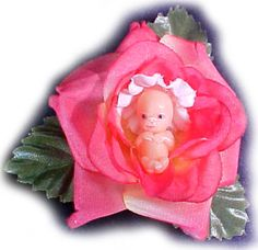Pro-life pin, representing unborn as baby-like and beautiful