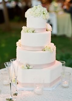 Wedding Cakes: Elegant White Cake with Flower Accents // Captured by Lisa Lefkowitz via Snippet & Ink