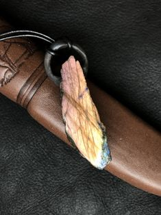Labradorite Pendant on leather cord from SIGIL. Leather Cord, Leather Bag, Labradorite, Bag Accessories, Trending Outfits, Pendant, Unique Jewelry, Handmade Gifts, Bags