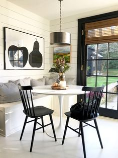 kitchen nook with Saarinen table, Enzo Mari Apple Pear Poster and painting by Lizzy Love