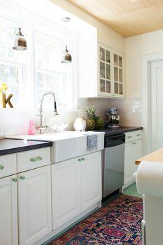 white kitchen | vintage rug in kitchen