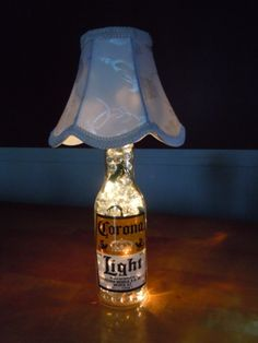 up cycling beer bottles - corona lights (Alcohol Bottle Lights) Beer Bottle Lights, Corona Bottle, Beer Bottles, Corona Beer, Beer Bottle Centerpieces, Beer Decorations, Reception Decorations, Beer Bottle Crafts, Frozen Crafts
