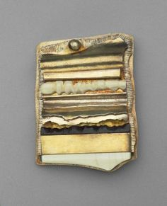 Olaf Skoogfors, brooch. silver gilt, ivory, black onyx. 1975