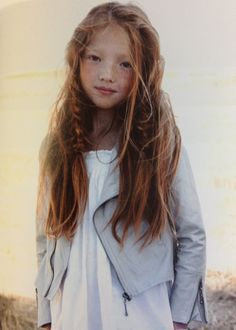 Asian little girl with reddish brown hair and freckles. Gorgeous long chestnut hair and sweet smile!