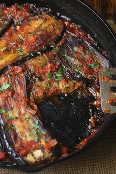 This Turkish dish is a healthy vegan twist on the usual breaded, fried eggplant casserole. The slices are covered in Mediterranean tomato sauce and baked.