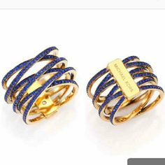 MK Michael Kors ring sz 8 NEW 100% authentic, with retail tags attached, pouch and booklet included. Royal blue pave crystals on a gold tone stainless steel criss- crossed body. $125MRSP. Got it as a gift, but too much sparkle for me. Michael Kors Jewelry Rings