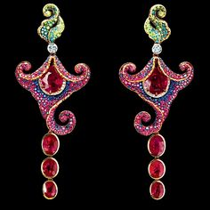 "Jewellery Theatre, Amaryllis  High Jewellery Earrings. 18K yellow gold, 8 oval ""pigeon blood"" Burmese rubies 19,90 ct, 465 rubies 3,53 ct, 39 diamonds 0,73 ct, 85 green diamonds 0,58 ct, 58 blue diamonds 0,47 ct, 322 sapphires 2,60 ct. Photo courtesy Jewellery Theatre."