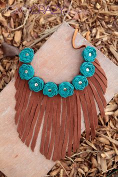 Leather flower fringe necklace. $58.00, via Etsy.