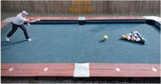 Former cage fighter Steve Wienecke built this pool table in his back yard and plays on it with bowling balls. The game, called Knokkers, is played like regular pool but uses a cue ball rather than a cue stick. It looks like crazy fun! Lawn Games, Backyard Games, Outdoor Games, Outdoor Play, Indoor Outdoor, Outdoor Living, Backyard Ideas, Bbq Games, Garden Games