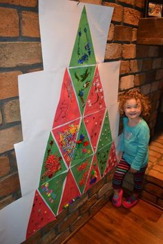 Class Christmas tree using triangles with 17 one will be the trunk