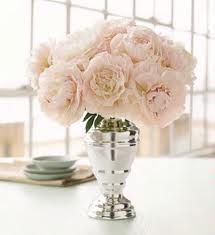 Maybe a mix of White Peony Centerpieces and the deep pink?