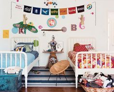 Don't usually go for the traditional pinks and blues but love this his and her's kids room
