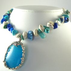 $60.00 ~ Wire wrapped Blue Agate with fresh pearls and howlite chips.  I have a piece of her jewlery; what a creative lady she is!