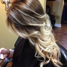 Long Curly Hairstyles 2014: Brown hair with blonde highlights