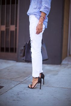 {White distressed denim and ankle-strap heels.}