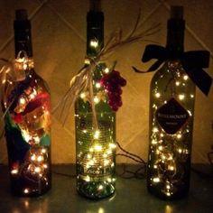 Making Wine Bottle Lights 17 Apart Over On Ehow Diy Wine Bottle Christmas Lights, All Bottles In A Row 8 Gorgeous Diy Wine Bottle Lighting Ideas, Calebs Lighted Wine Bottles For Bottle Lamps Diy Show Off Page, Lighted Wine Bottles, Bottle Lights, Bottle Lamps, Empty Bottles, Glitter Bottles, Christmas Lights, Christmas Holidays, Christmas Decorations, Bottle Decorations