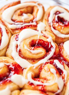 Strawberry Sweet Rolls with Vanilla Cream Cheese Glaze - Soft, buttery rolls loaded with sweet strawberry jam are an automatic hit! There's an overnight/make-ahead option so you can pop them into the oven whenever you're ready!!