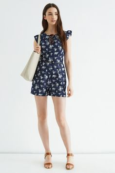 DITSY CHAMBRAY PLAYSUIT www.teelieturner.com Own the denim trend this season with this hot-to-trot chambray playsuit. The pretty flower print adds that extra Summery splash we all love during the warmer months. #fashion