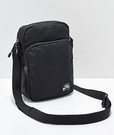 86a7f31fab5bed Accessorize your look while creating convenience for yourself with the  Heritage shoulder bag from Nike SB. A small black canvas bag offers two  zippered ...