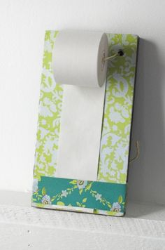 It kind of looks like toilet paper, but it is NOT! It is a roll of paper! So cute for people who like lists!