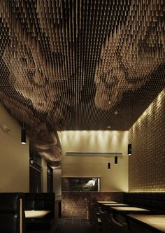 Ceiling clouds made with 25,000 wooden sticks at Tsujita restaurant in Los Angeles, California by Takeshi Sano