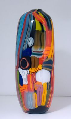 """This """"Valises"""" piece from HokansonDix Glass has a multi-color murrini pattern that floats over a black-and-white background."""